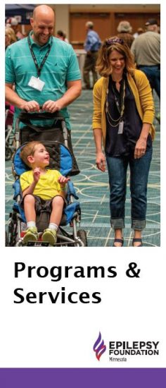 Brochure cover — a man and a woman smile while standing while a child in a stroller, and title, Programs & Services.