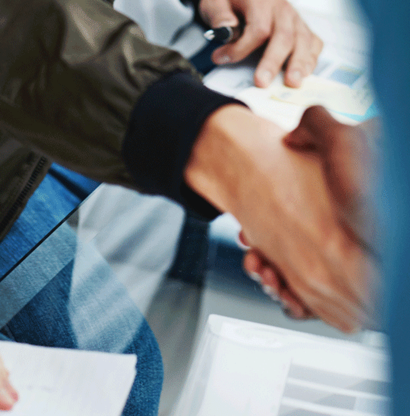 A closeup of a handshake, representing the nonprofit financial statements.