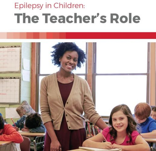 Booklet cover — image of a teacher smiling with her arm around a student sitting at her desk, surrounding by other students working, and title, Epilepsy in Children: The Teacher's Role.
