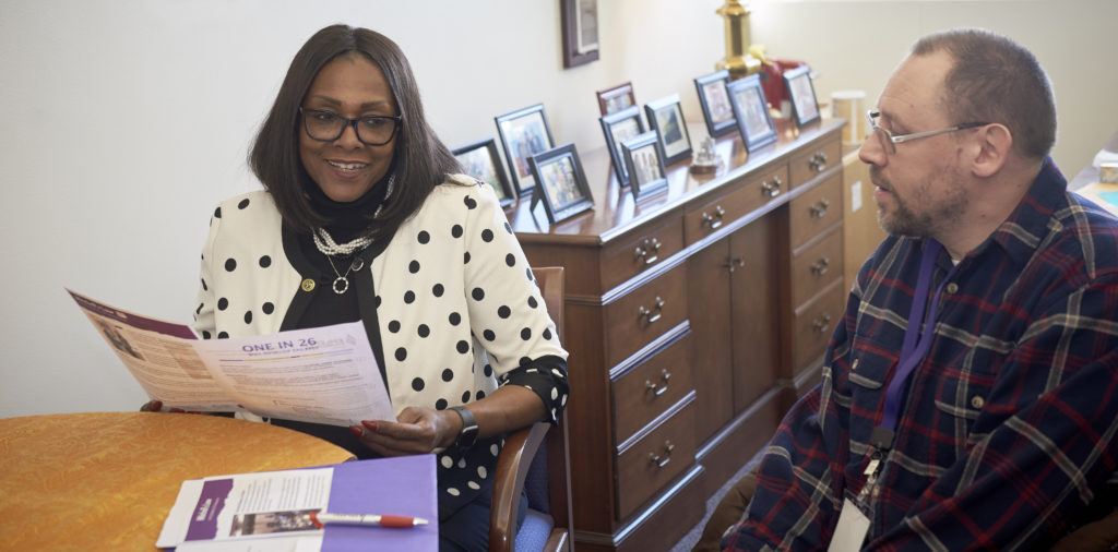 A representative meets with her constituent in her office
