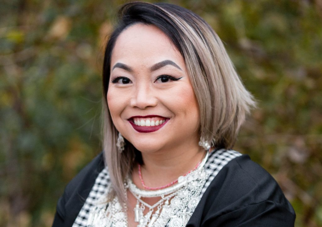 Hmong woman dressed up and smiling