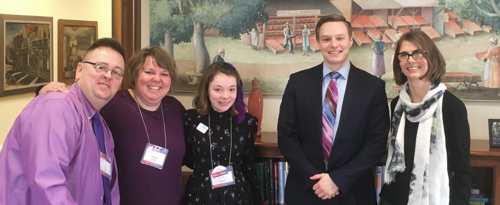 Poshek family with EFMN advocacy director Heather Besonen at political office