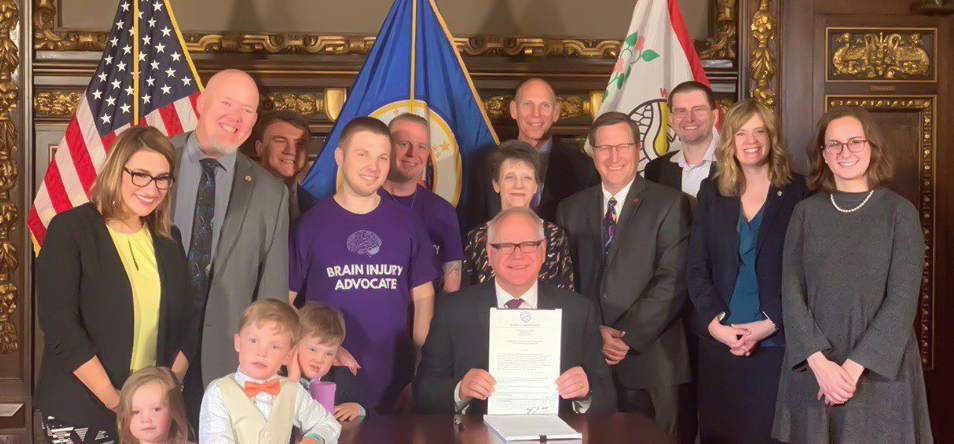Governor Tim Walz and advocates signing bill into law